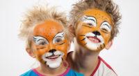 Kinderschminken mieten - Zwei Jungs mit Löwen-Motiv